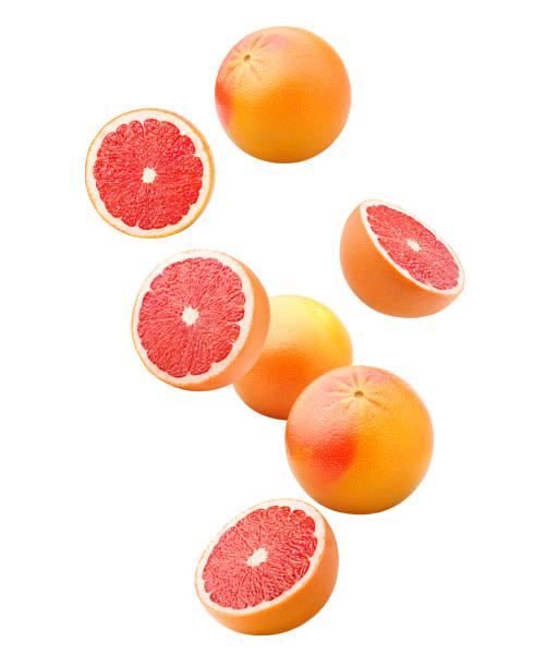 Falling grapefruits isolated on white background, clipping path, full depth of field Falling grapefruits isolated on white background, clipping path, full depth of field orange fruit stock pictures, royalty-free photos & images