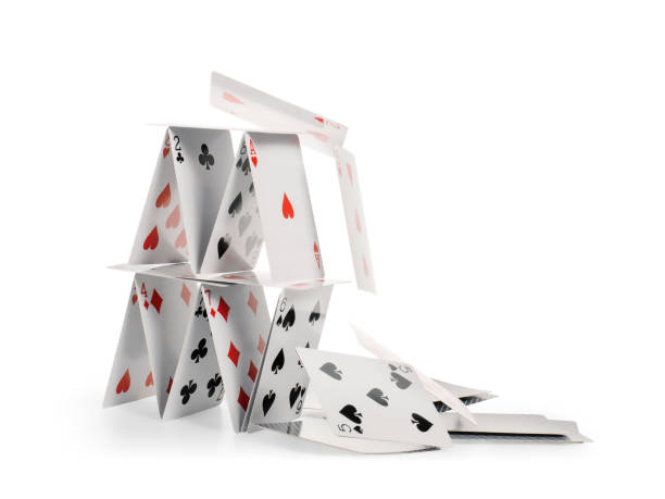 Falling house of cards isolated with clipping path Crashed house of cards. Falling cards isolated on white, clipping path included collapsing stock pictures, royalty-free photos & images
