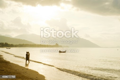 istock Falling in love couple on the beach 458672783