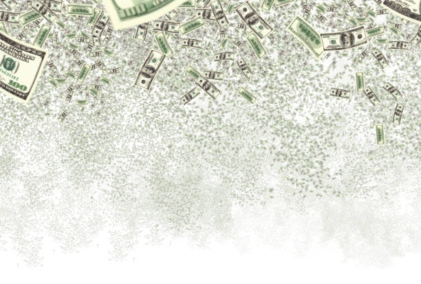 falling large group of money of American dollar bills isolated over white stock photo