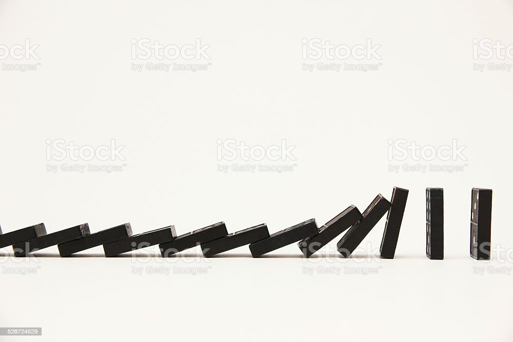 Falling line of dominoes stock photo