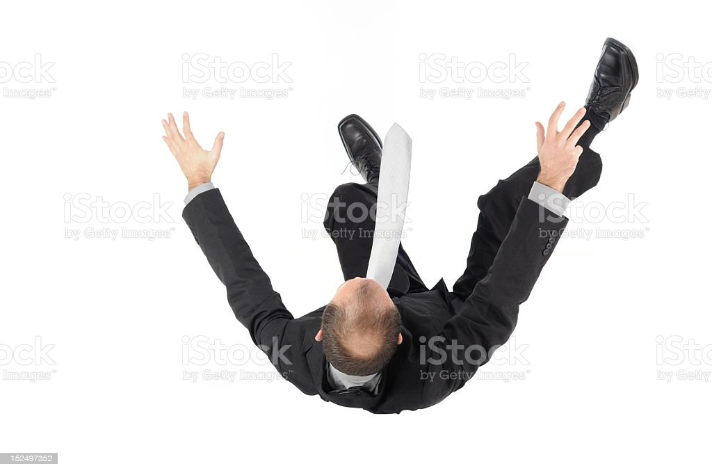Falling man in black business suit stock photo