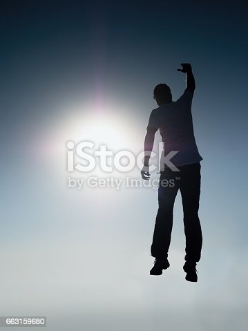 istock Falling man. Man fly in air. Man falling down with hands up. 663159680