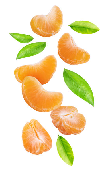 Falling mandarins isolated on white background Falling mandarins isolated on white background. Clipping path tangerine stock pictures, royalty-free photos & images