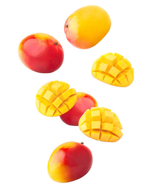 Falling mango isolated on white background, clipping path, full depth of field Falling mango isolated on white background, clipping path, full depth of field mango stock pictures, royalty-free photos & images