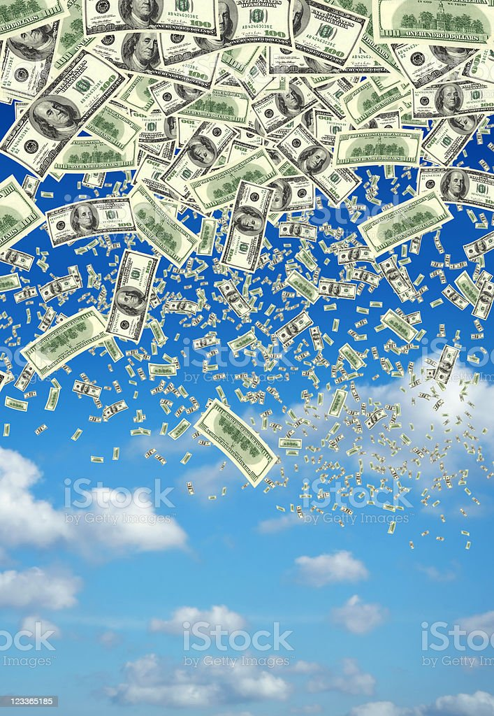falling money over clear sky stock photo