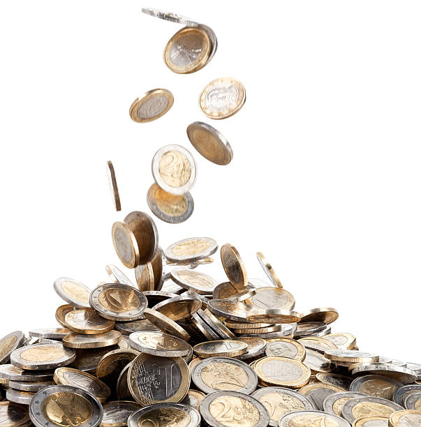 falling motion of euro coins onto a mound of money - coin stock photos and pictures