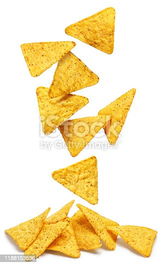 Falling delicious mexican nachos chips, isolated on white background