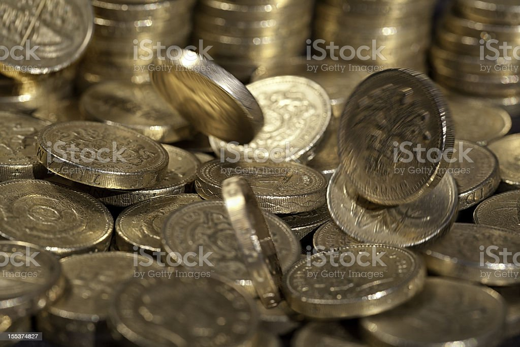 Falling one pound coins, money series royalty-free stock photo