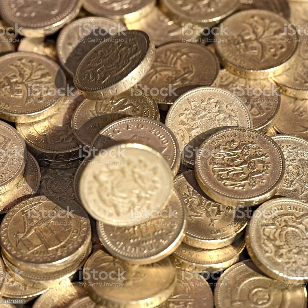 Falling one pound coins royalty-free stock photo