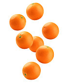 Falling orange isolated on white background, clipping path, full depth of field