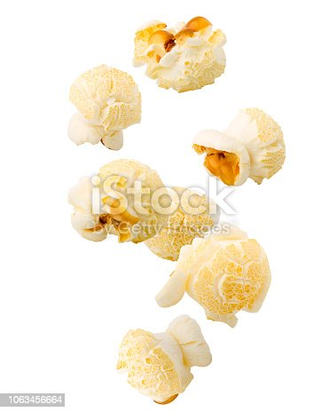 Falling popcorn, isolated on white background, clipping path, full depth of field