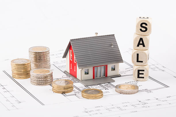 Falling prices on real estate offers stock photo