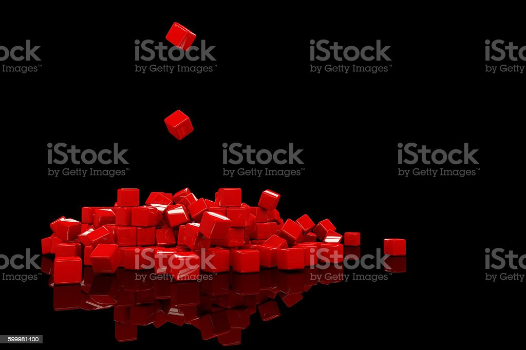 falling red cubes creating a pile on a black surface stock photo