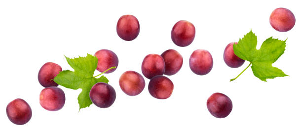 Falling red grape isolated on white background stock photo