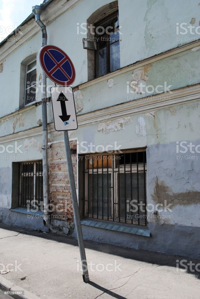 falling road sign no parking stock photo