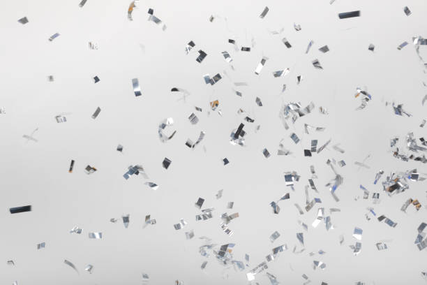 falling silver confetti pieces - confetti stock pictures, royalty-free photos & images