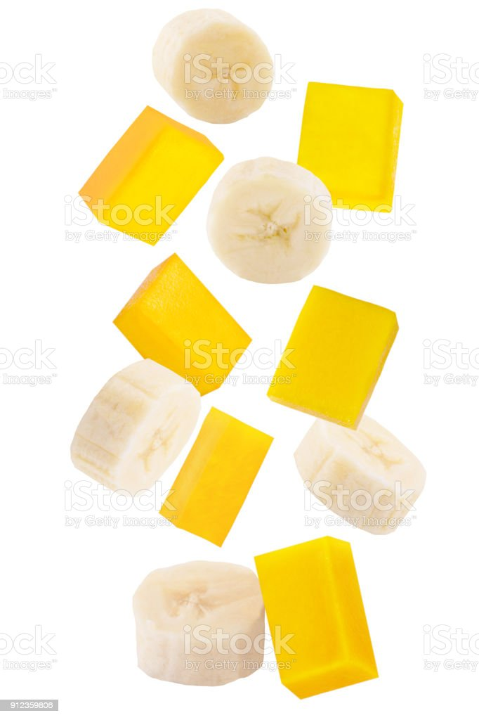 Falling sliced banana and mango isolated on white - foto stock