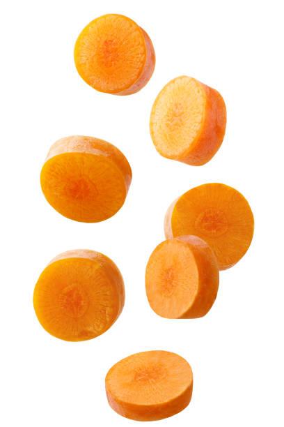 falling sliced carrot isolated on white background - cenoura imagens e fotografias de stock