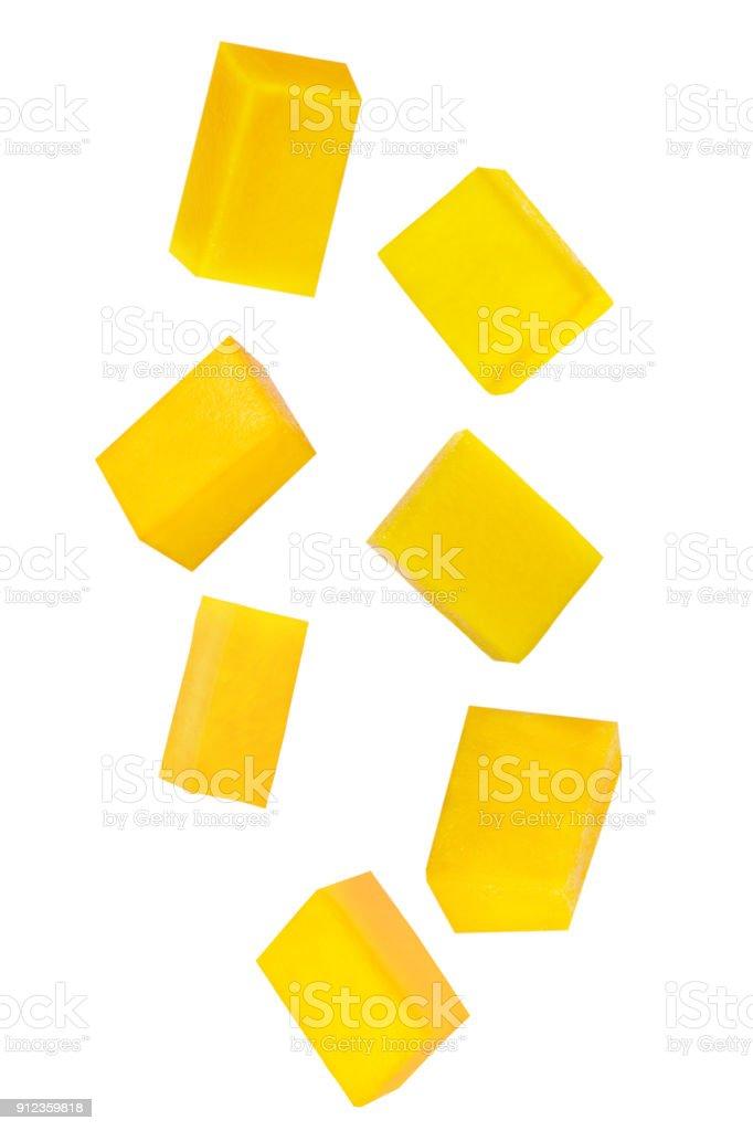 Falling sliced mango fruit isolated on white - foto stock