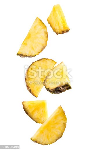 istock Falling slices of pineapple isolated on white 918703488