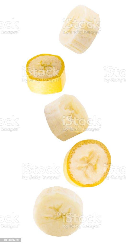 Falling slised banana fruits isolated on white - foto stock