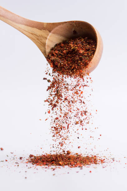 falling spices on a white background stock photo