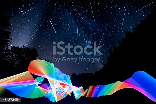 night view with falling stars and abstract colorful lights.