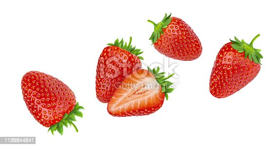 Falling strawberries isolated on white background with clipping path