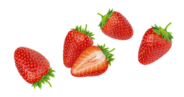 falling strawberries isolated on white background - strawberry imagens e fotografias de stock