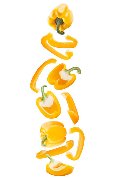 Falling sweet yellow pepper isolated on white background with clipping path as package design element and advertising. stock photo