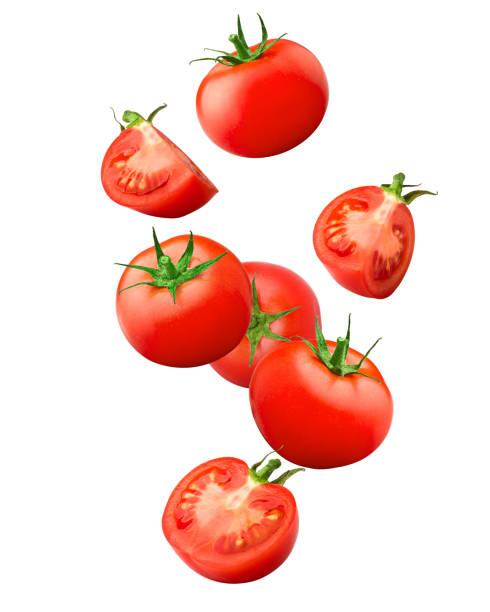 fallende tomate isoliert auf weißem hintergrund, clipping-pfad voller schärfentiefe - 25 cent stück stock-fotos und bilder