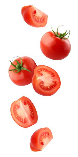 クリッピングで白い背景に分離されたトマトの落下 - トマト ストックフォトと画像