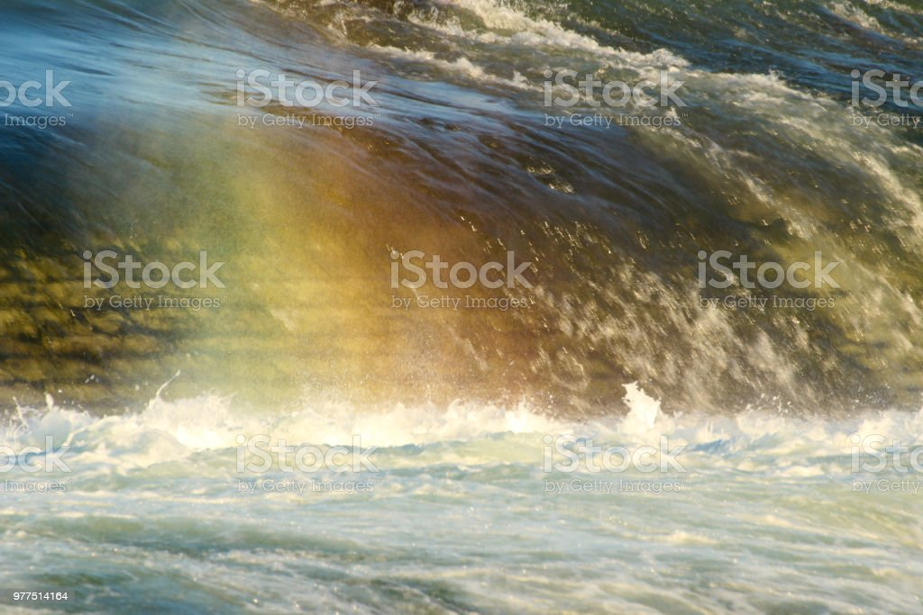 Falling water and rainbow colors stock photo