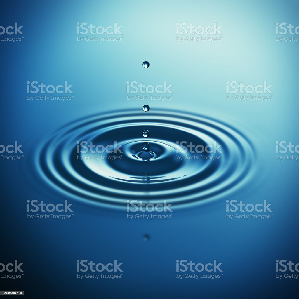 Falling water drop makes waves stock photo