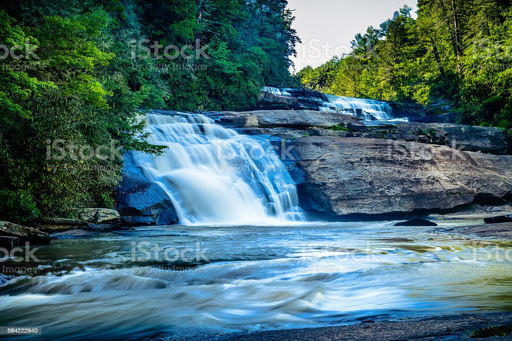 Falling waters of the Triple Falls in North Carolina stock photo
