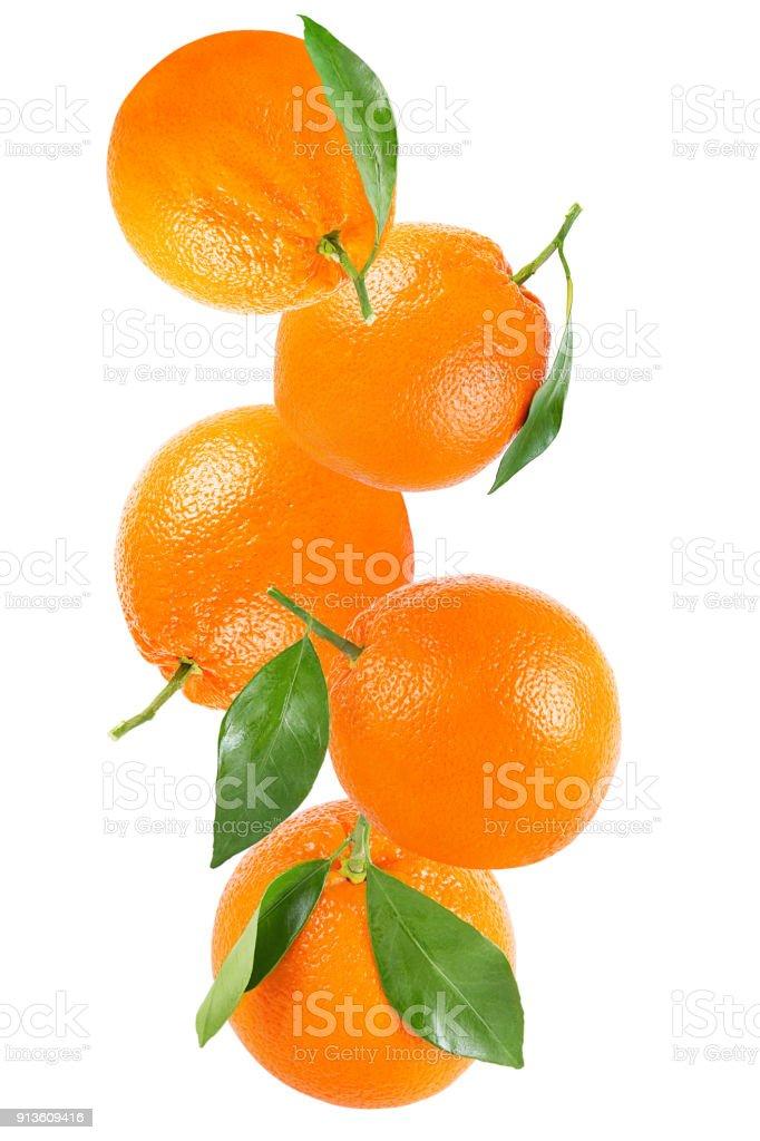 Falling whole orange isolated on white - foto stock