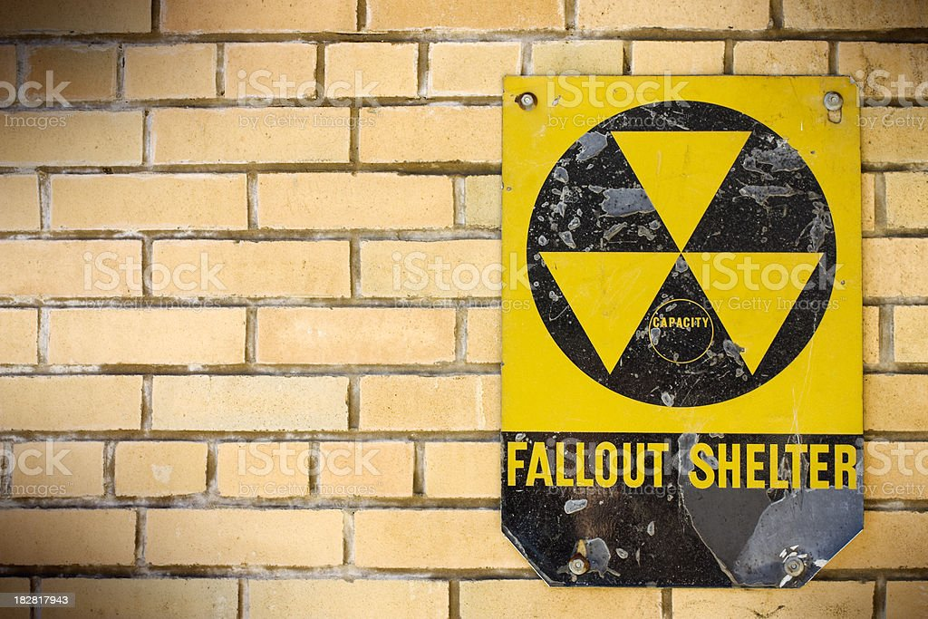 Fallout Shelter on a brick wall stock photo