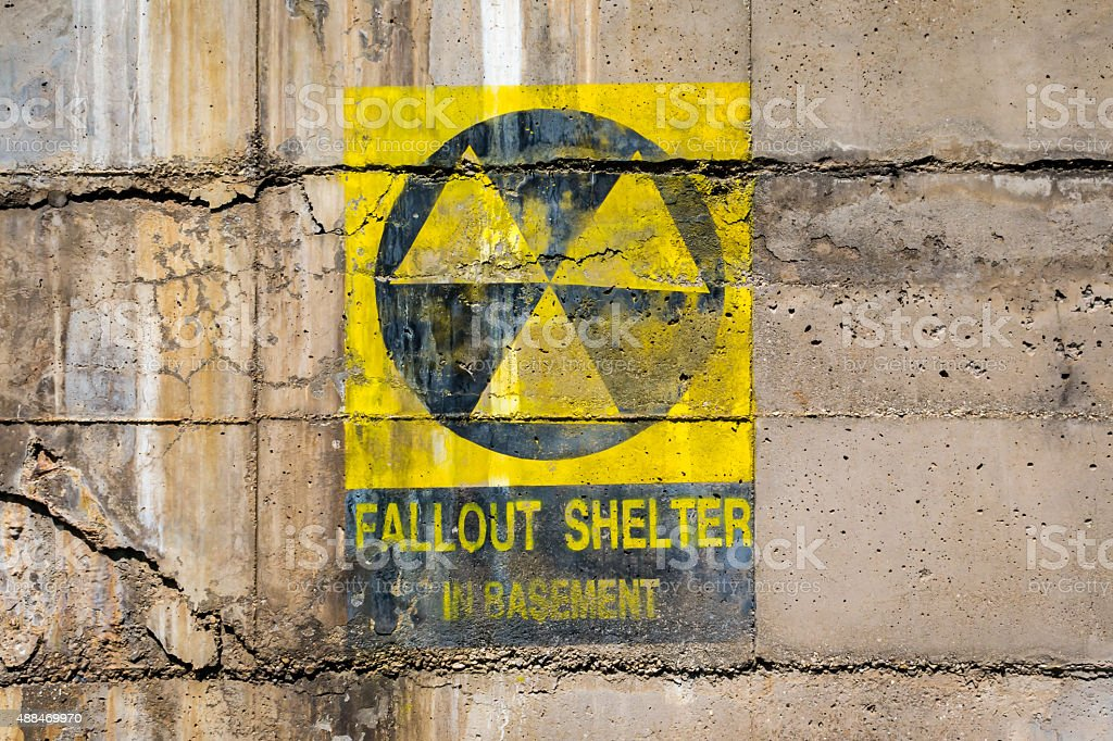 Fallout Shelter painted sign painted on cracked wall stock photo