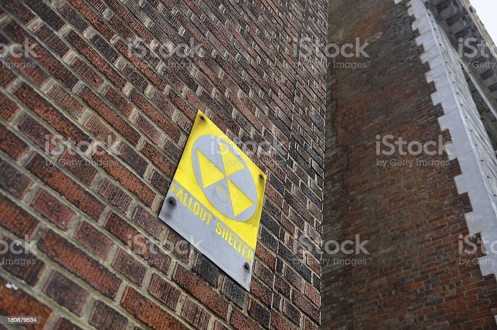 Fallout Shelter Sign on Red Brick Wall stock photo