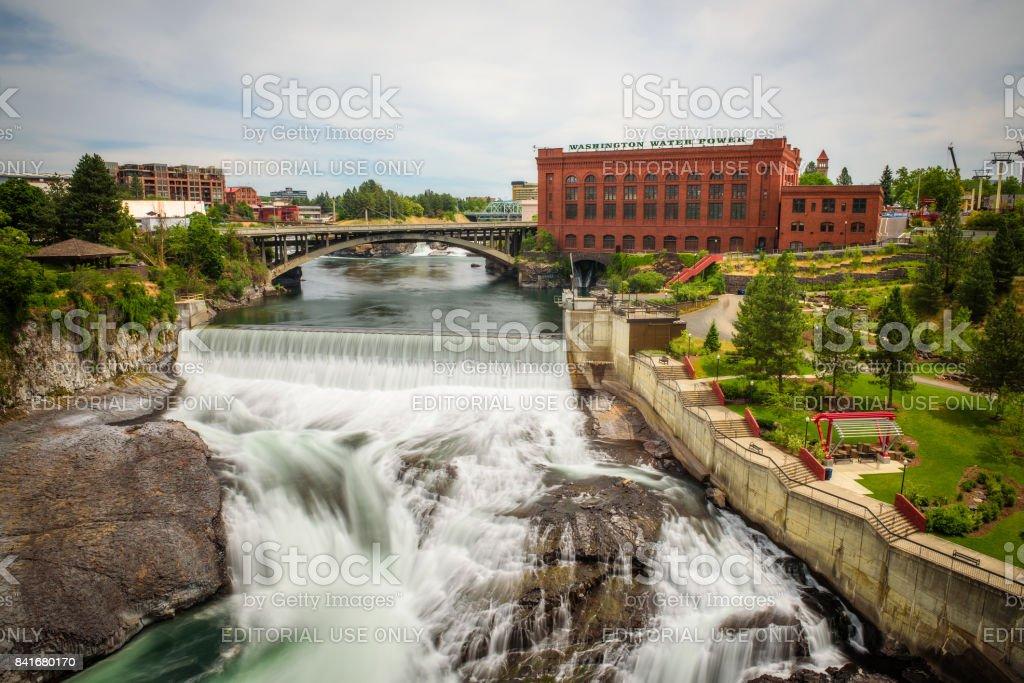 Falls and the Washington Water Power building along the Spokane river stock photo