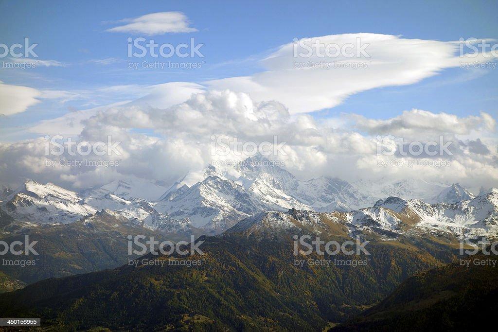 Fall's and winter's beauty - mountain range in Switzerland stock photo