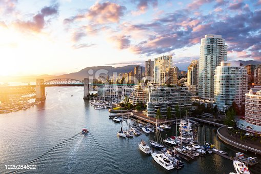 False Creek, Downtown Vancouver, British Columbia, Canada. Beautiful Aerial View of a Modern City on the West Pacific Coast during a colorful Sunset. Sky Composite