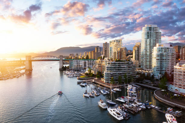 False Creek, Downtown Vancouver, British Columbia, Canada. False Creek, Downtown Vancouver, British Columbia, Canada. Beautiful Aerial View of a Modern City on the West Pacific Coast during a colorful Sunset. Sky Composite british columbia stock pictures, royalty-free photos & images