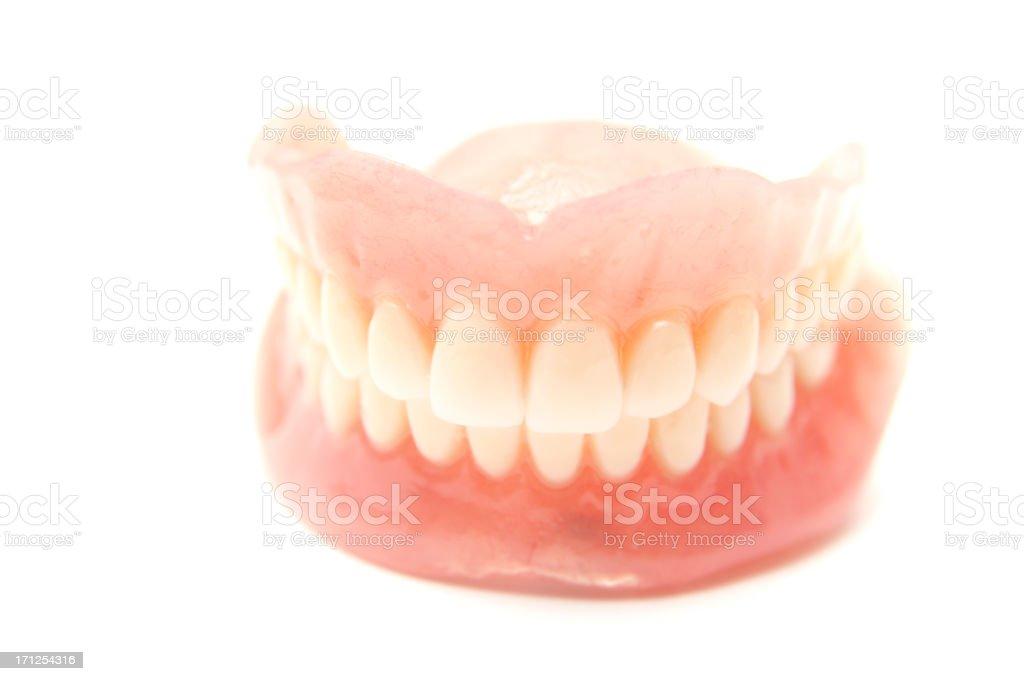 False teeth on white background stock photo