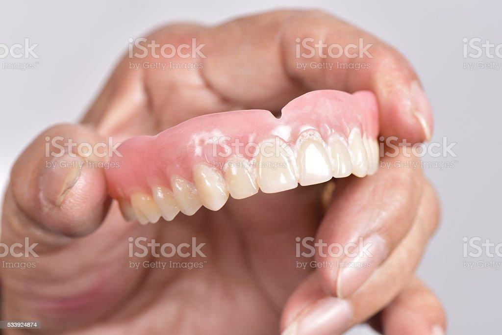 false tooth stock photo