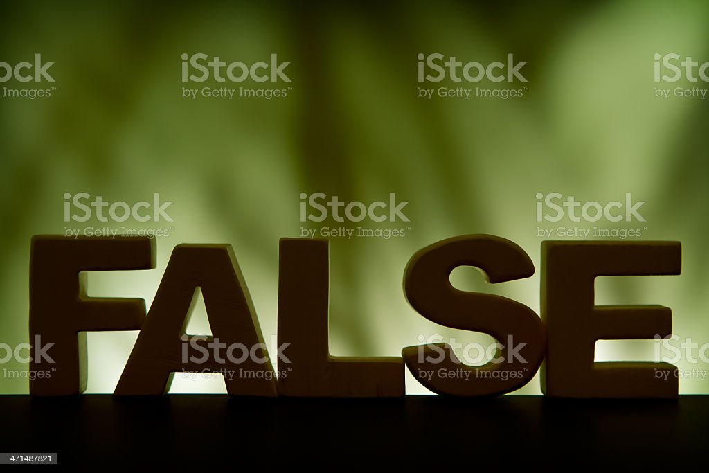 False, wood letter word royalty-free stock photo