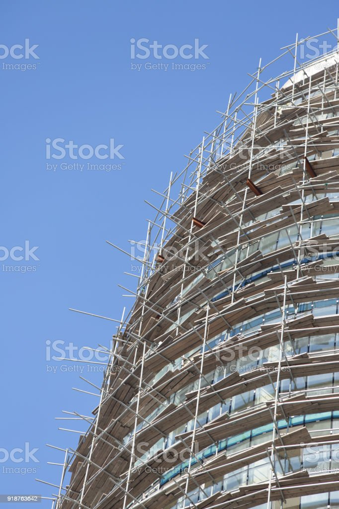 Falsework on a facade of the under construction house. stock photo