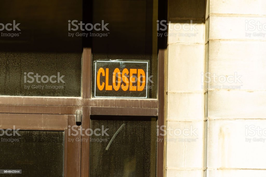 familar sight a closed sign posted in a downtown building royalty-free stock photo