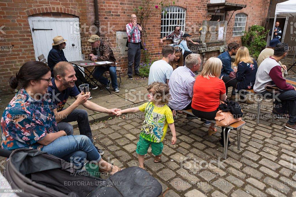 Familes enjoying small comunity outdoor event stock photo